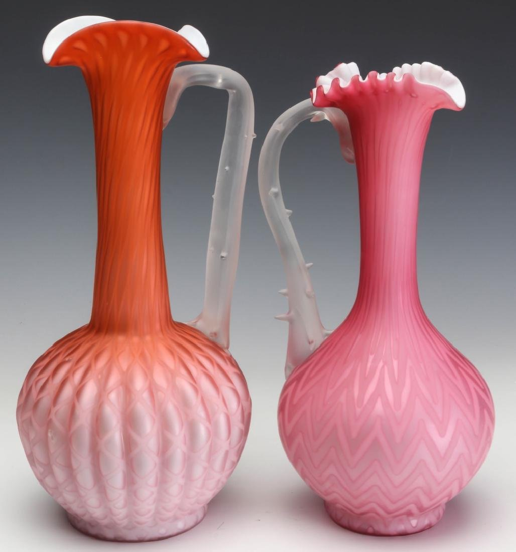 TWO TALL SLENDER MOTHER OF PEARL GLASS EWERS
