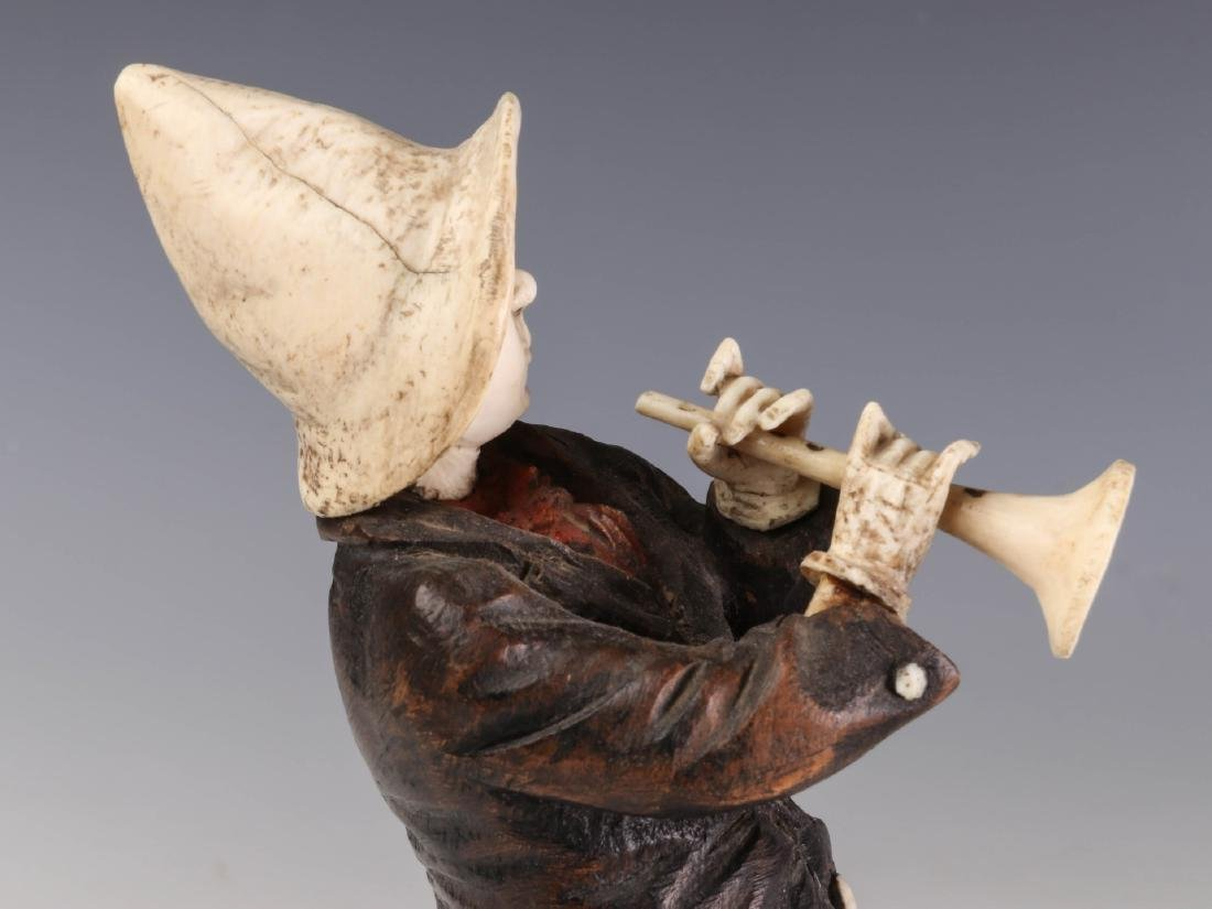 A 19TH C. CONTINENTAL CARVED WOOD AND BONE FIGURE - 8