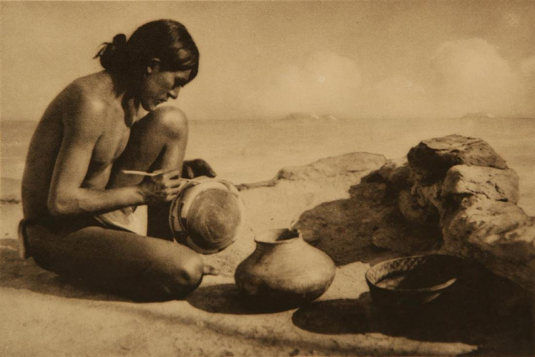 ROLAND W. REED PHOTOGRAVURE: HOPI POTTERY MAKER