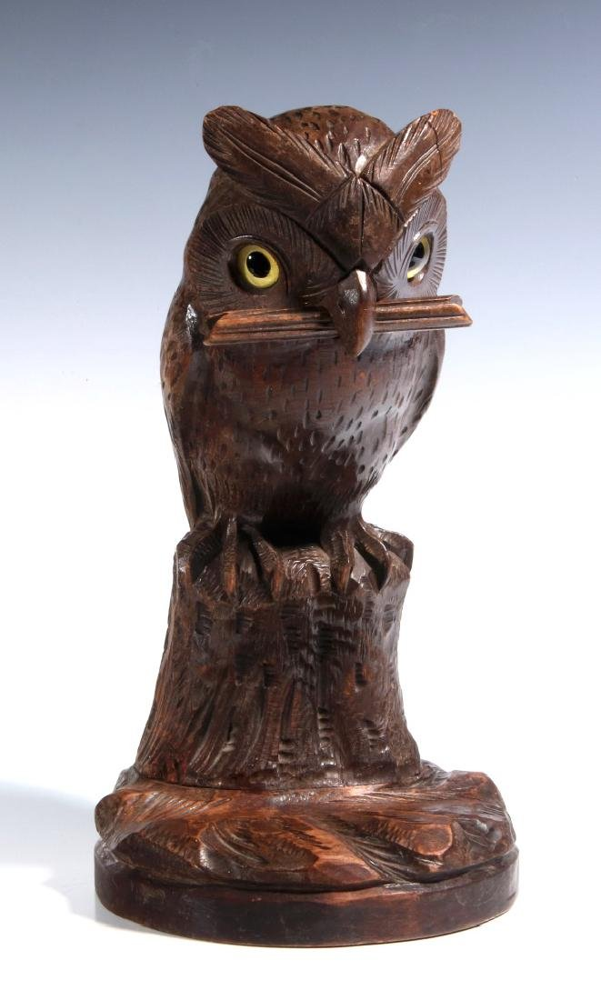 A BLACK FOREST CARVED WOOD OWL FORM WATCH HANGER