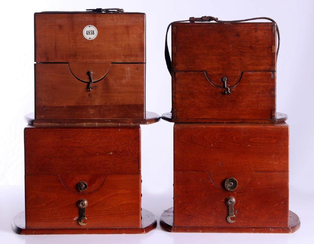 FOUR 20TH CENTURY MAHOGANY CHRONOMETER CASES