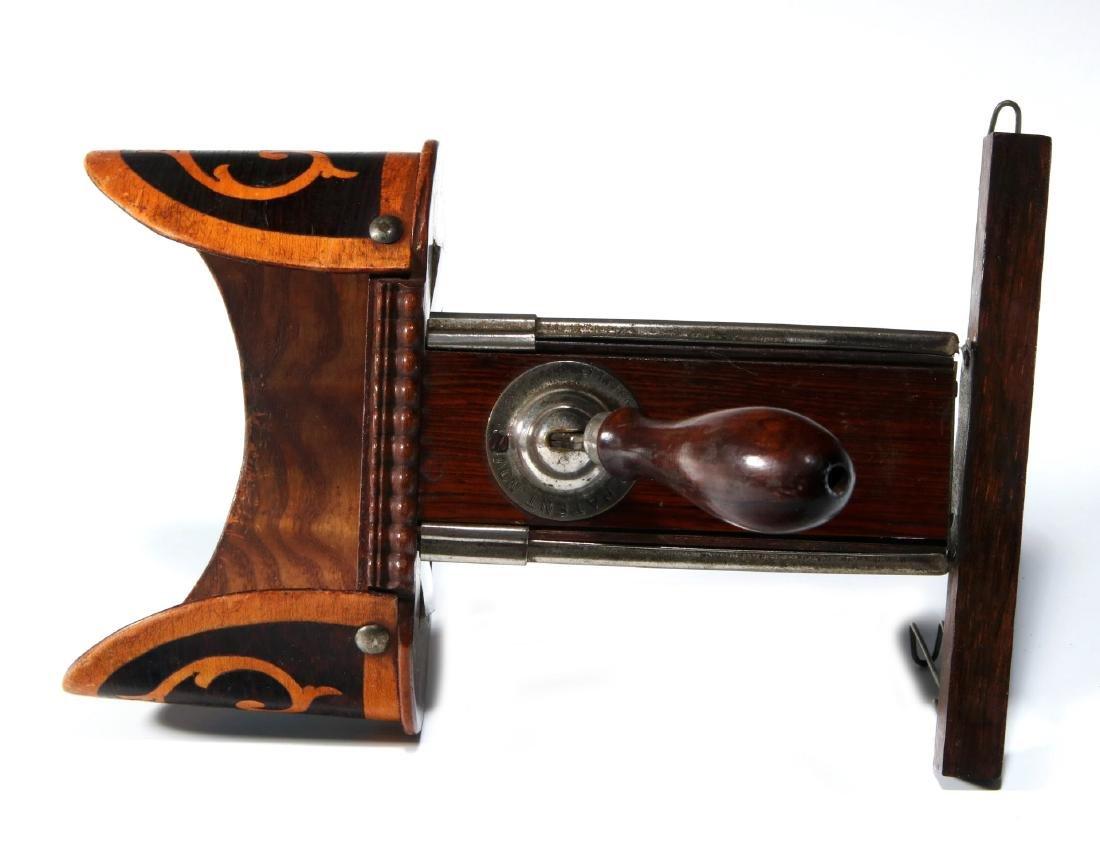 A 19TH CENTURY HAND-HELD STEREOSCOPE - 4