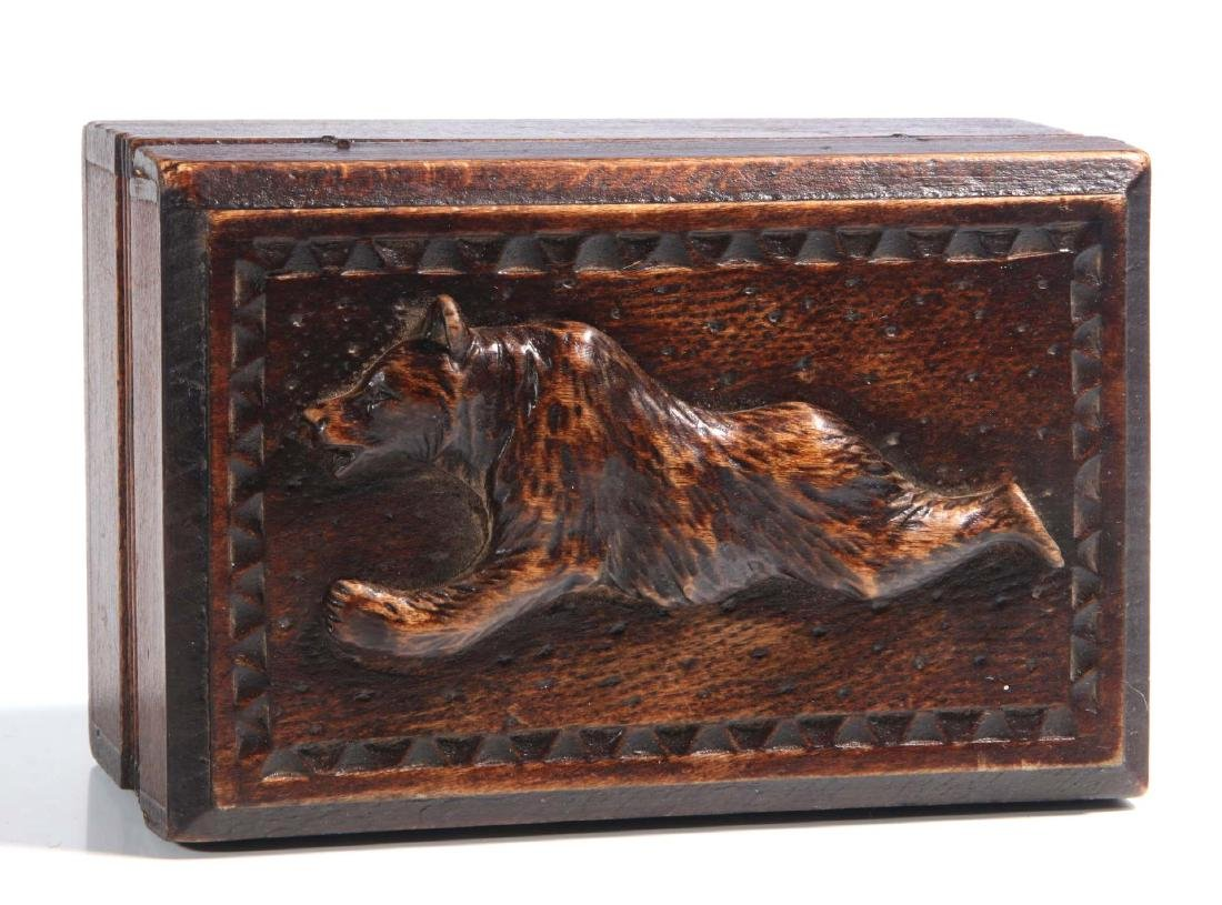 A CIRCA 1900 BLACK FOREST PUZZLE BOX WITH BEAR