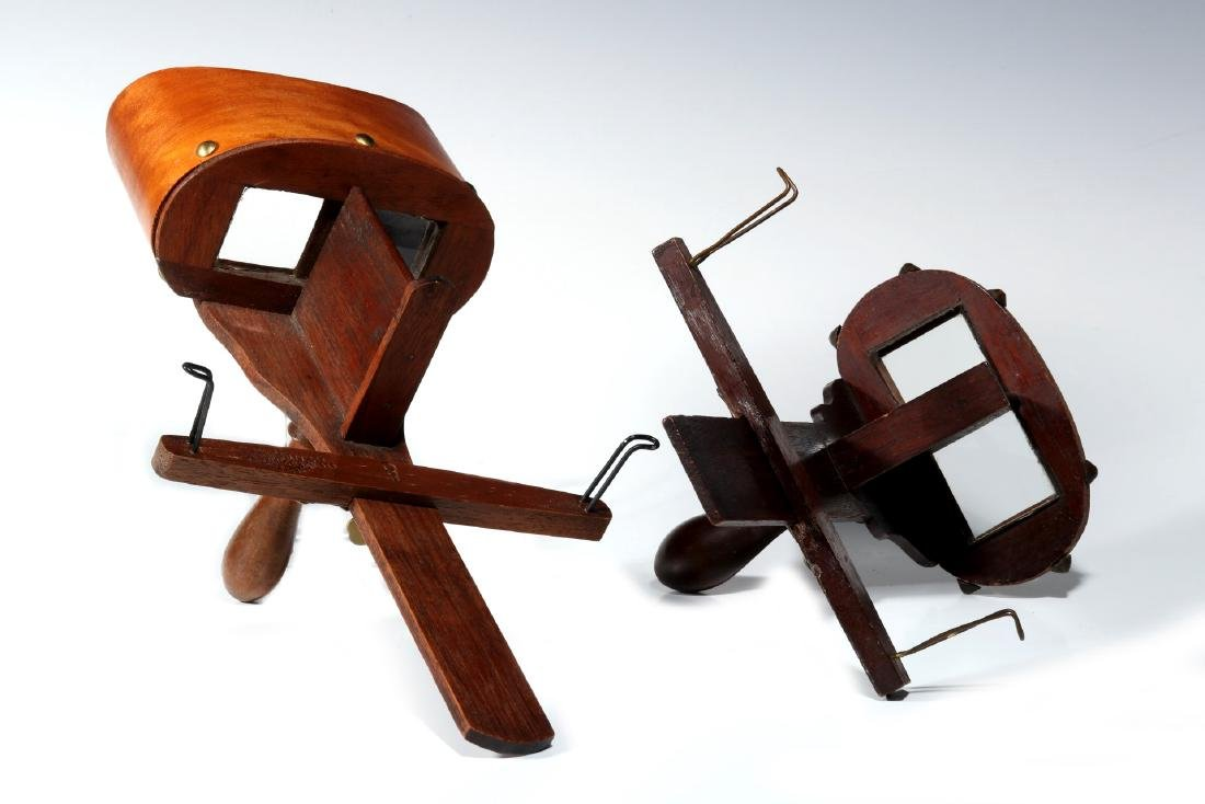 TWO 19TH CENTURY HAND-HELD STEREOSCOPES