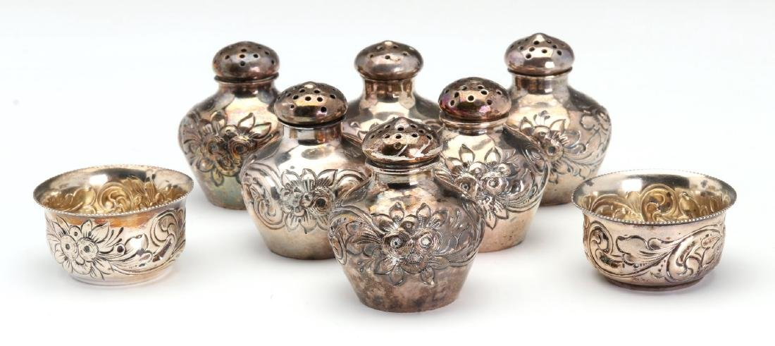 GEO C. SHREVE STERLING SILVER REPOUSSE SHAKERS