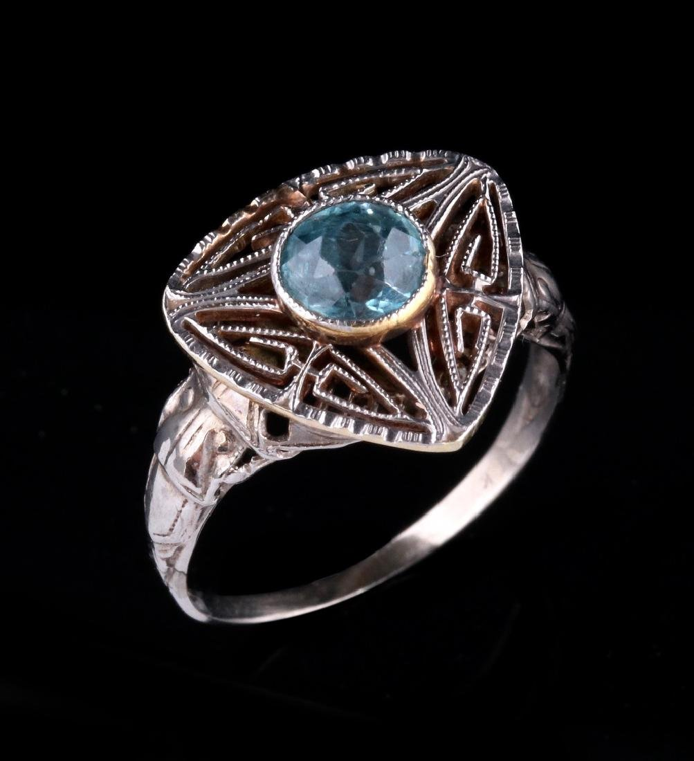 PLATINUM FILIGREE RING WITH BLUE GEMSTONE