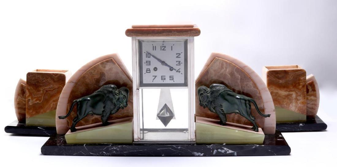 AN UNUSUAL FRENCH ART DECO CLOCK SET WITH BUFFALO