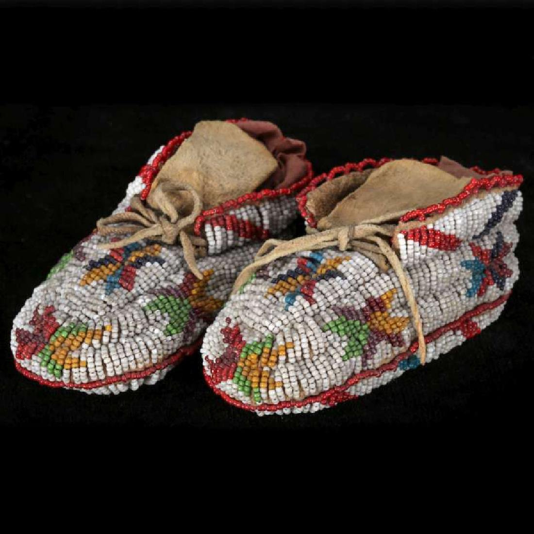 EARLY 20TH C. CHILD'S MOCCASINS WITH BEADED SOLES