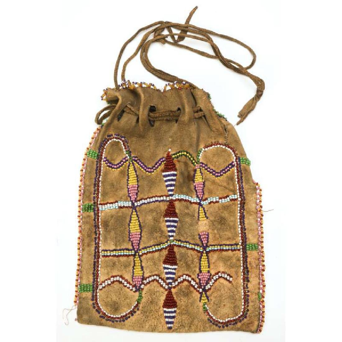 A CIRCA 1900 APACHE PARTIALLY BEADED BAG