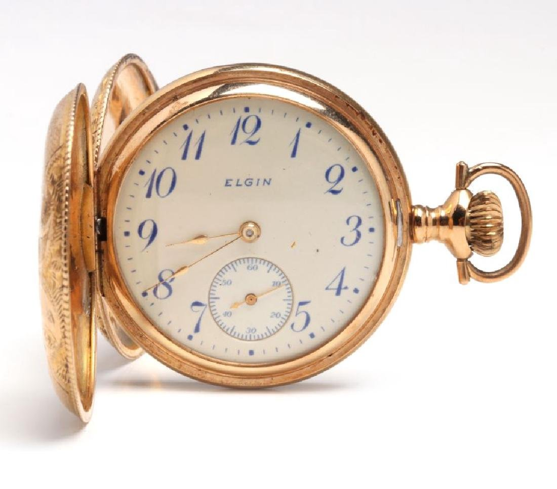 AN ELGIN SOLID 14K GOLD LADIES HUNTING CASE WATCH