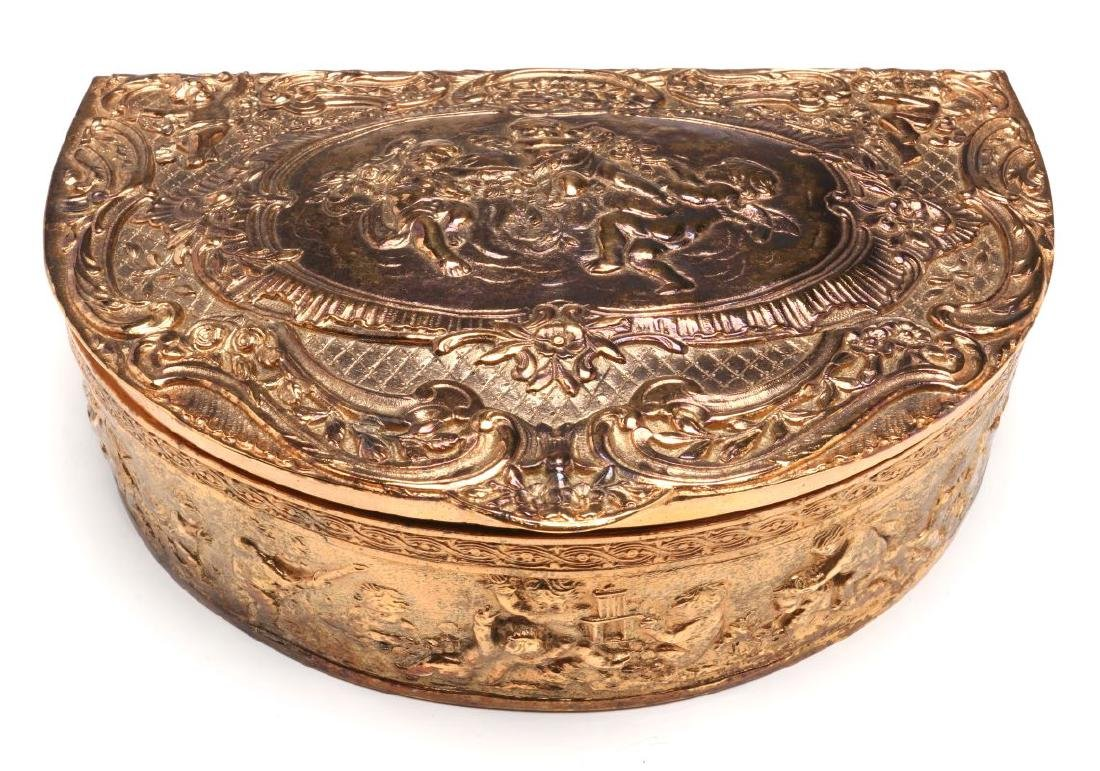A FRENCH DEMILUNE FORM GILT SILVER PLATED BOX