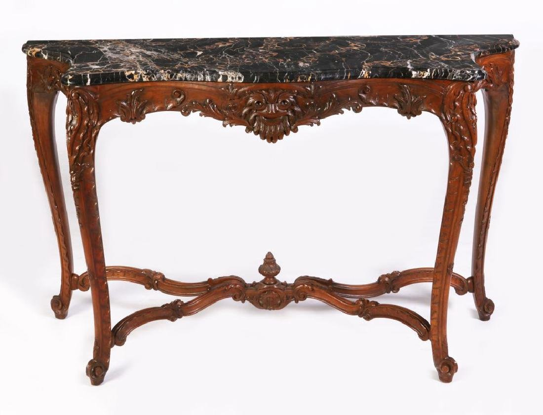 A LOUIS XV STYLE HIGHLY CARVED WALNUT CONSOLE
