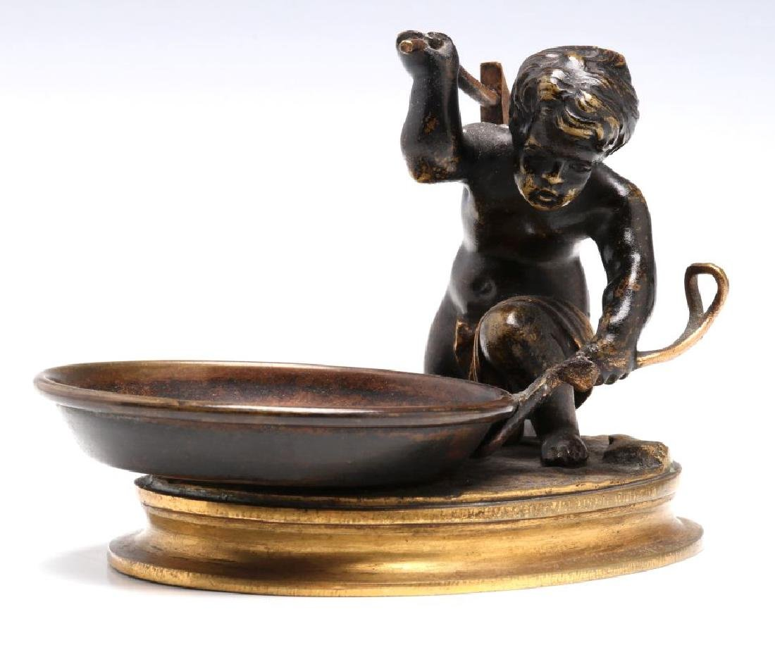 A SMALL 19TH CENTURY CABINET BRONZE OF CUPID BLACKSMITH