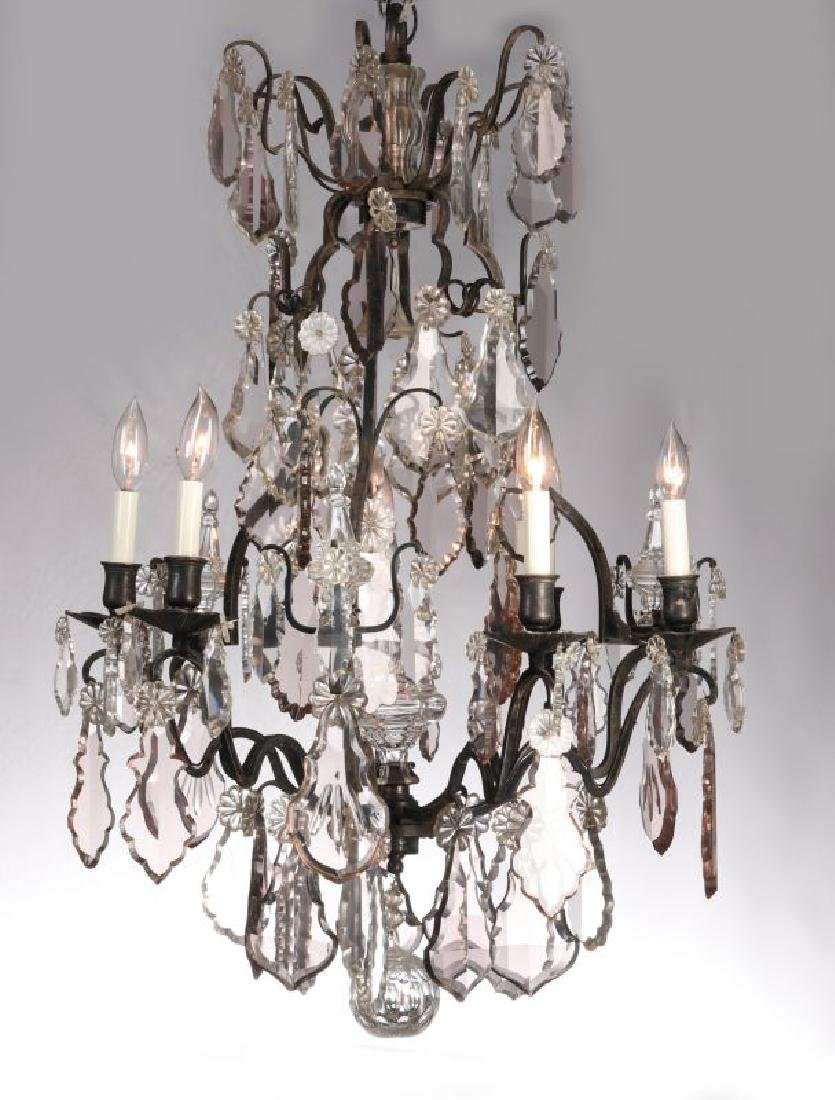 A FABULOUS OXIDIZED BRONZE NINE LIGHT CHANDELIER