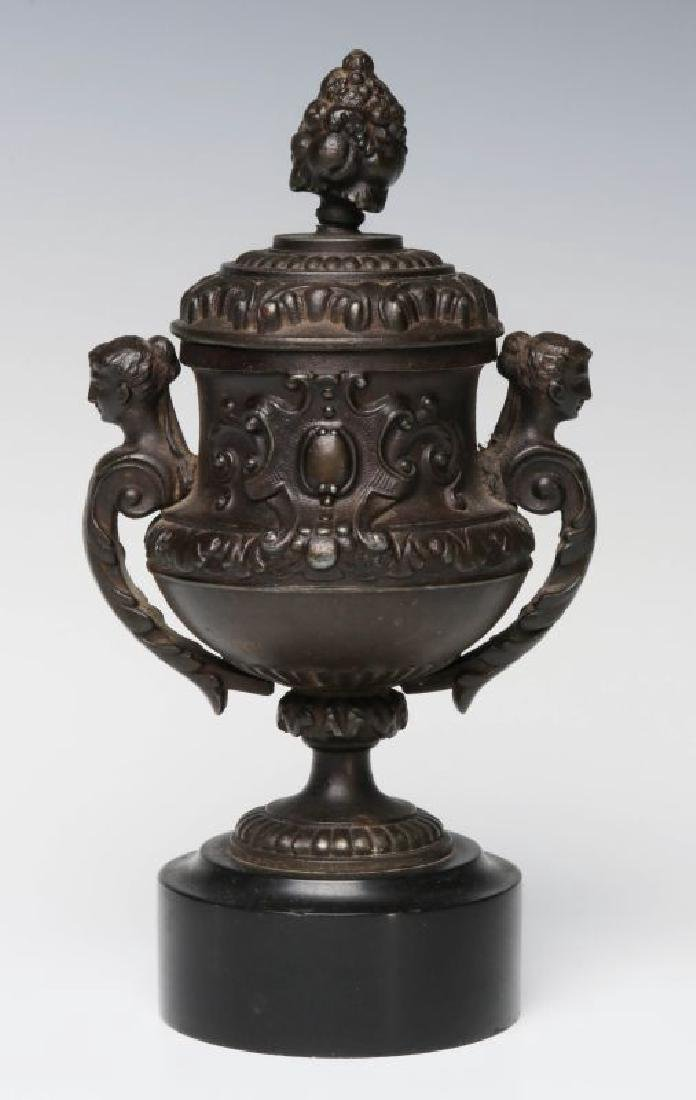 A SMALL 19TH CENTURY PATINATED SPELTER URN