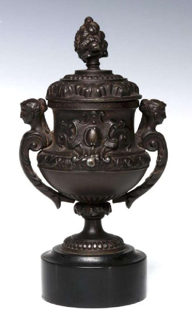 A SMALL 19TH CENTURY PATINATED SPELTER URN - 7