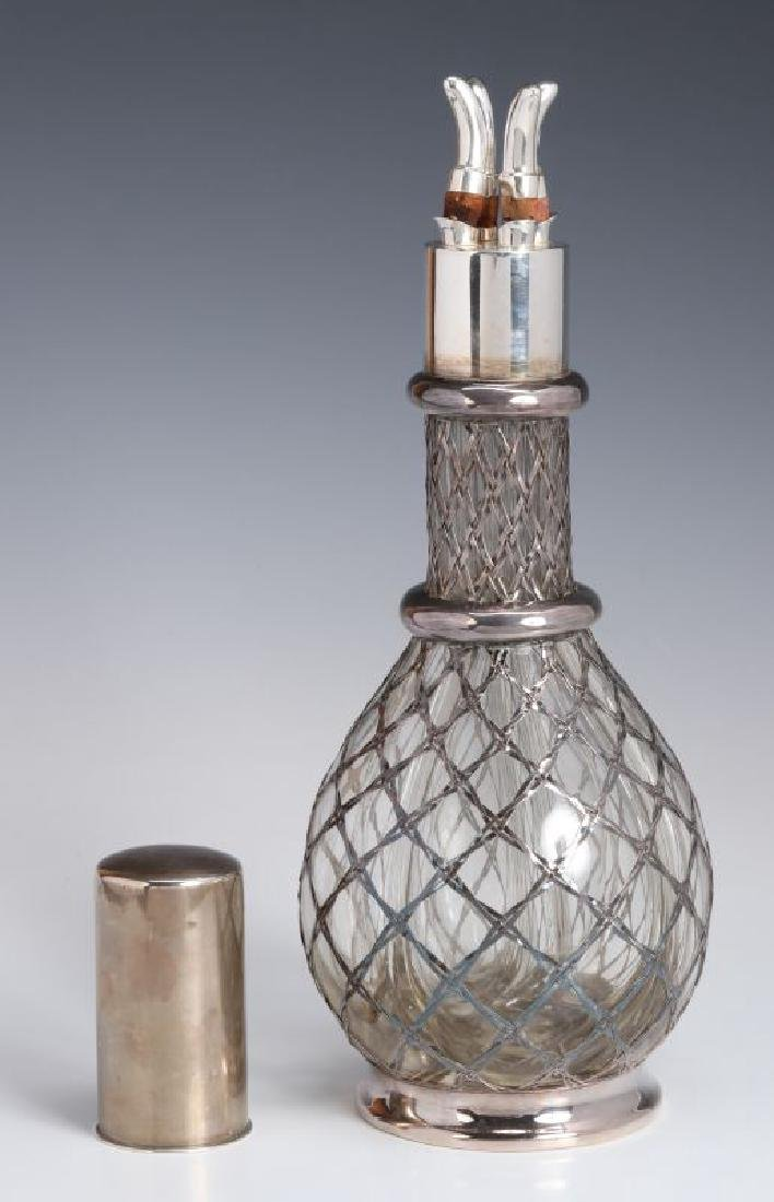 A FRENCH STERLING WRAPPED FOUR-CHAMBER BOTTLE