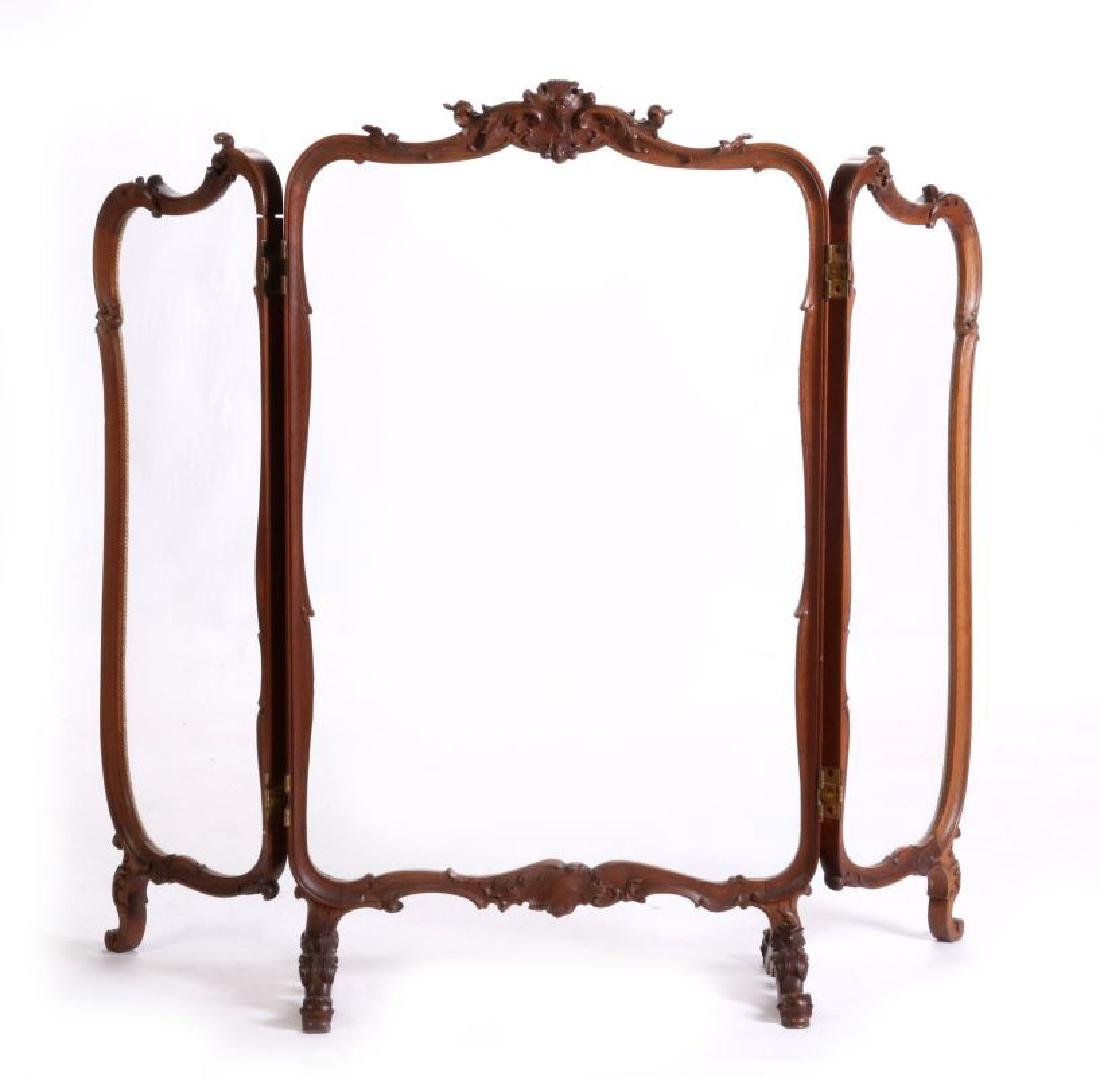 A HIGHLY CARVED ROCOCO REVIVAL WALNUT  SCREEN