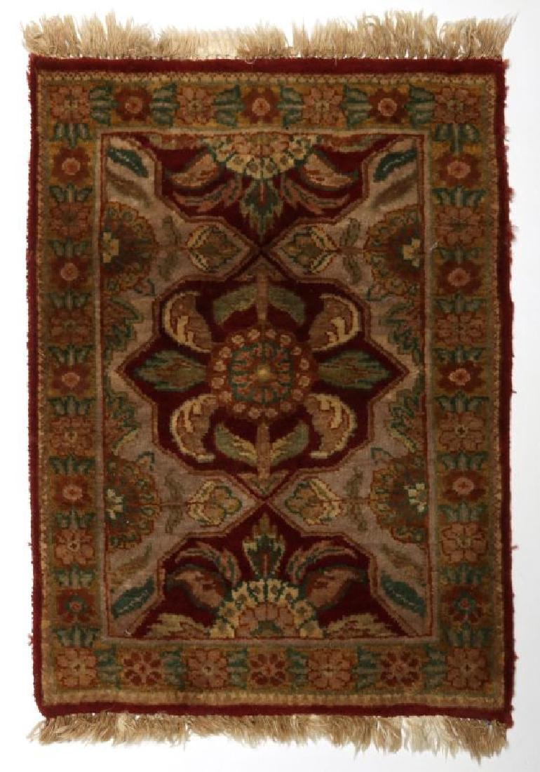 A SMALL 20TH CENTURY TURKISH RUG