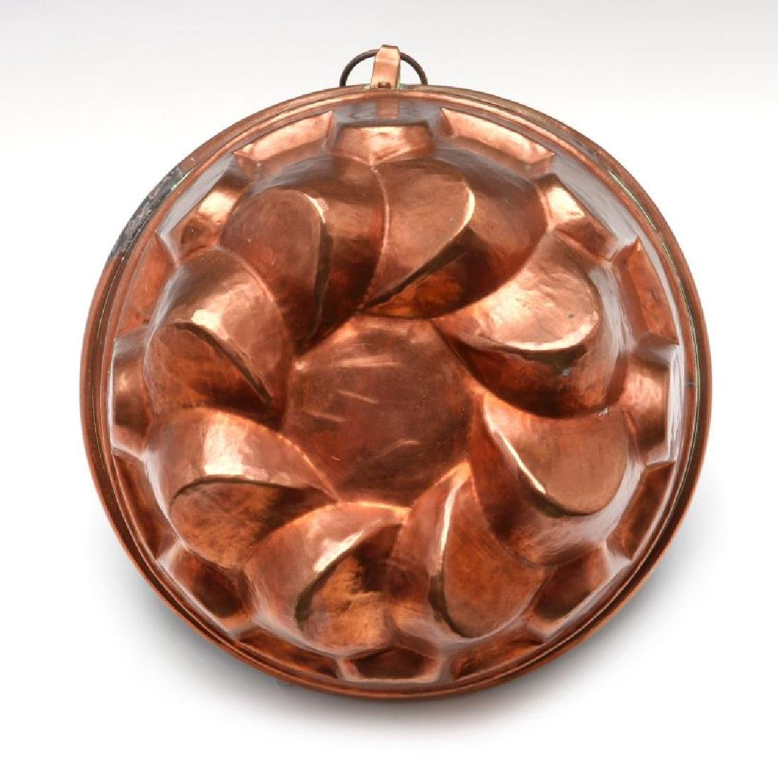 AN ANTIQUE HAMMERED COPPER FOOD MOLD