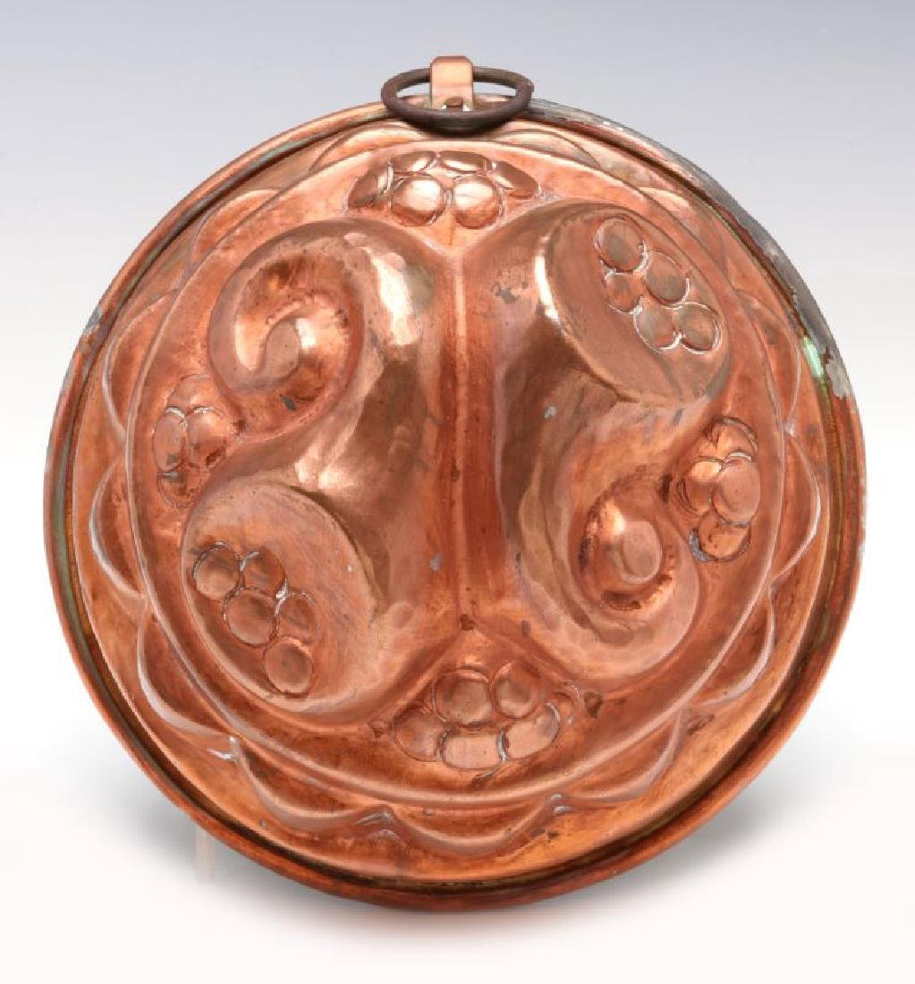 AN ANTIQUE COPPER FOOD MOLD