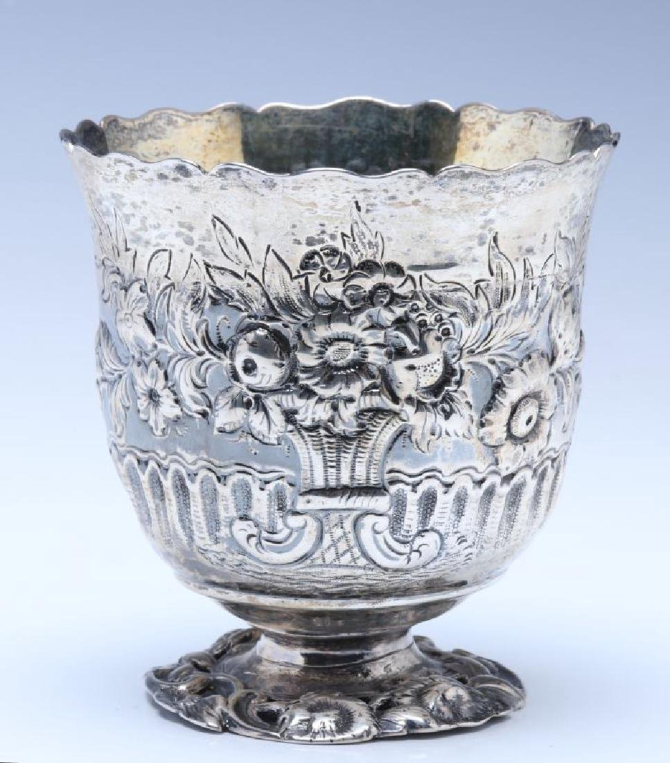 A BRITANNIA SILVER VASE OR CUP ON FOOT DATED 1722