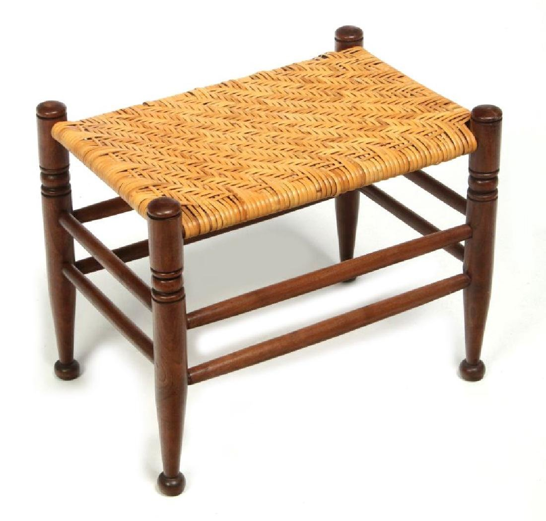 AN EARLY  20TH CENTURY RATTAN TOP FOOT STOOL
