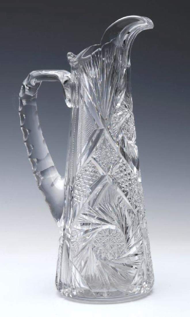 AN ABP CUT GLASS EWER,  13-INCHES