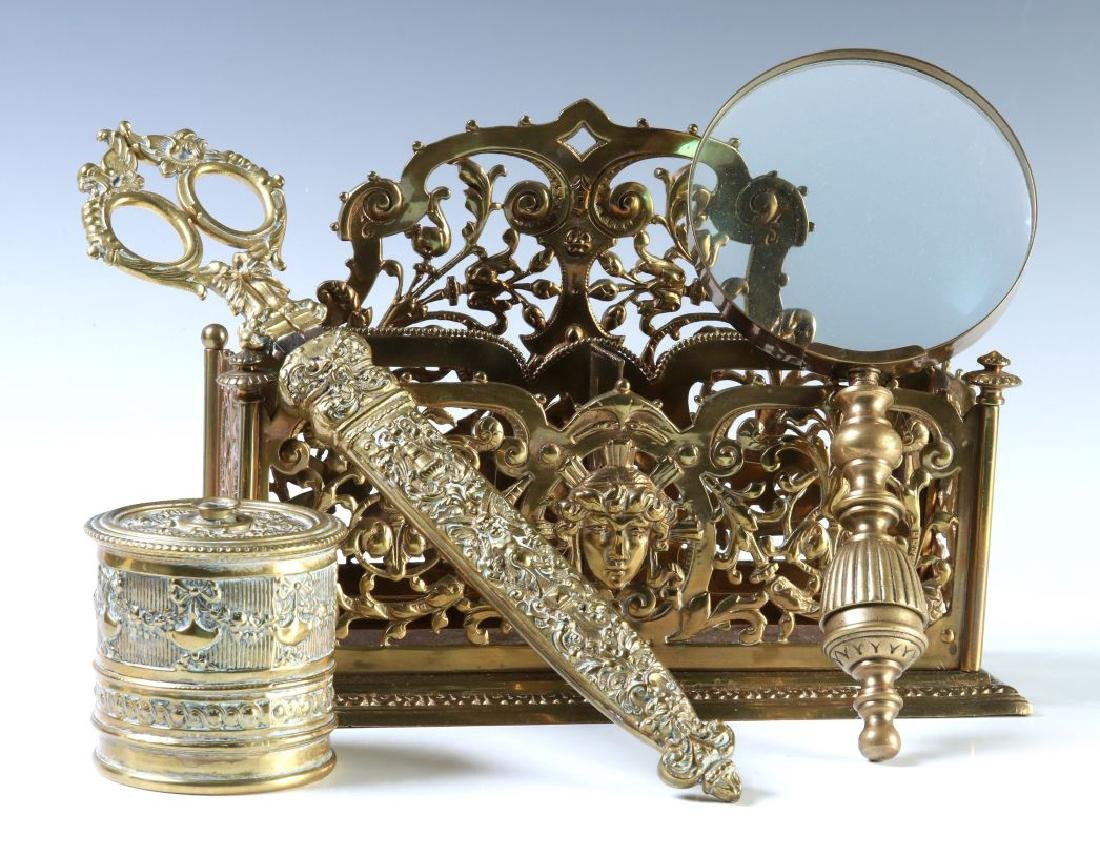 A COLLECTION OF ORNATE BRASS VICTORIAN DESK ITEMS