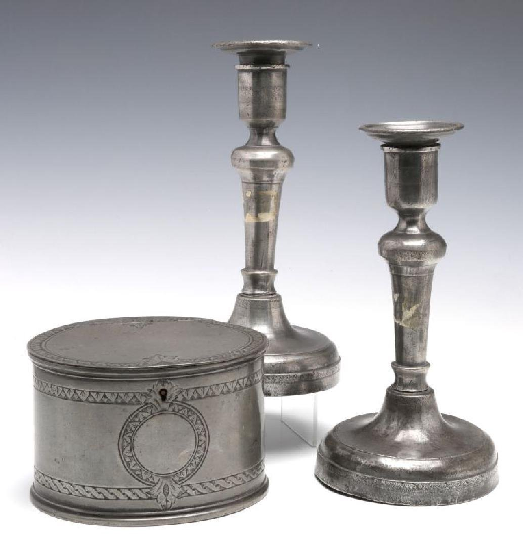 18TH C. . PEWTER CANDLE STICKS GROUPED WITH A TEA CADDY