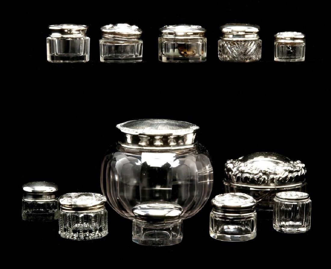 TWELVE STERLING SILVER TOPPED DRESSER JARS