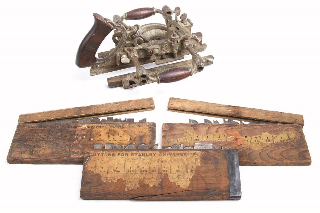 A STANLEY NO. 55 UNIVERSAL PLANE WITH CUTTERS