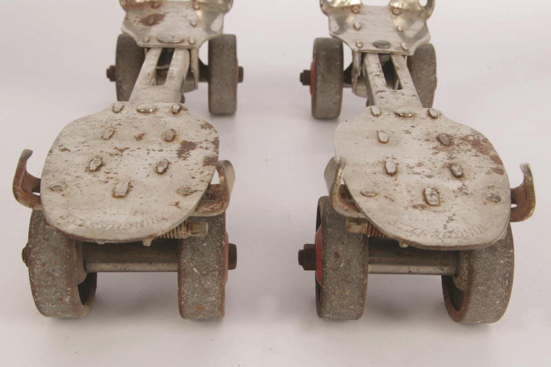 A PAIR OF VINTAGE WINCHESTER ROLLER SKATES - 6