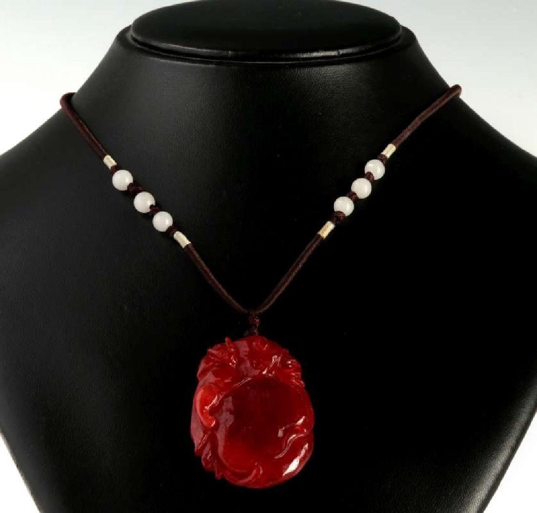 A CARVED RED JADE PENDANT - 2