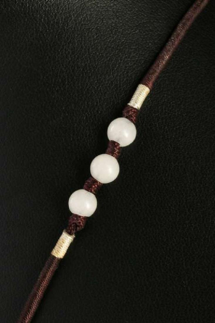 A CARVED RED JADE PENDANT - 4