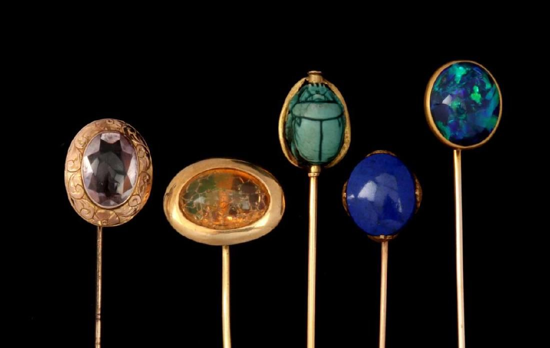 A COLLECTION OF 14K GOLD JEWELED STICK PINS