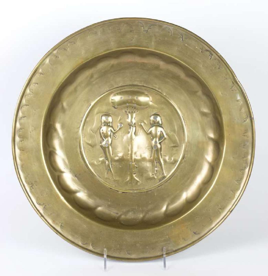 A 17TH / 18TH CENTURY EMBOSSED BRASS ALMS PLATE