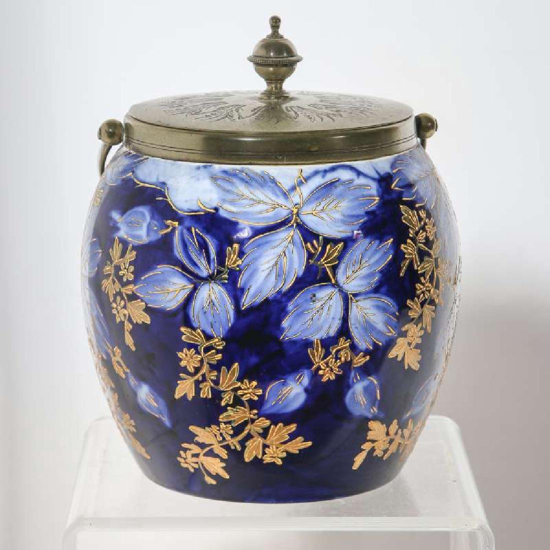 A GOOD FLOW BLUE BISCUIT JAR CIRCA 1890
