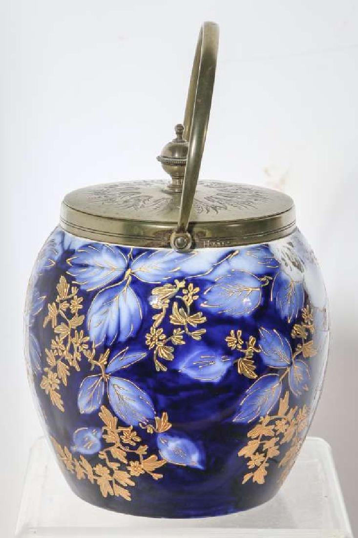 A GOOD FLOW BLUE BISCUIT JAR CIRCA 1890 - 2
