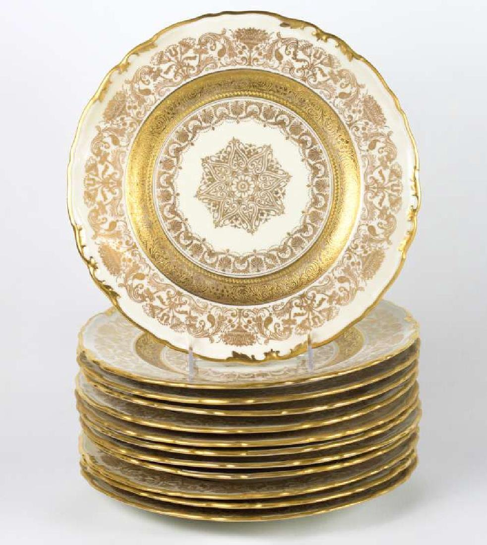 TWELVE EPIAG CORONET GOLD ENCRUSTED SERVICE PLATES
