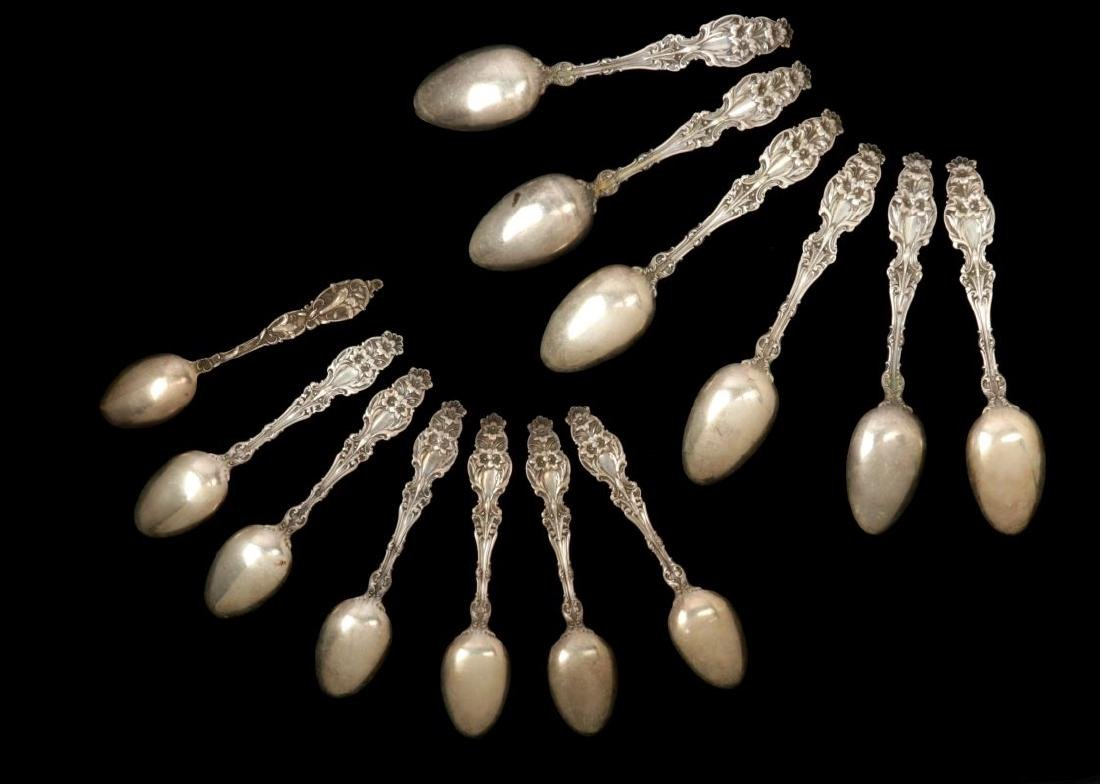 THIRTEEN WHITING CO 'LILY' PATTERN STERLING SPOONS - 8