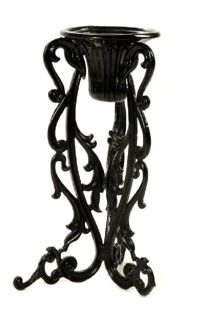 AN UNUSUAL VICTORIAN CAST IRON PLANTER ON STAND