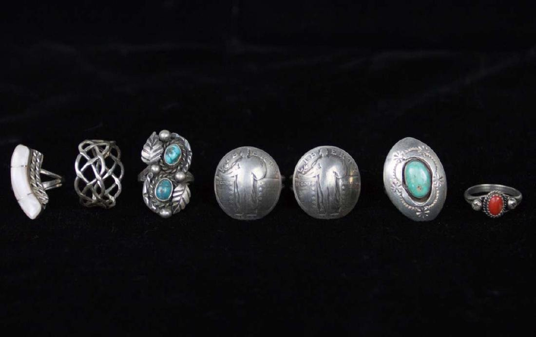 SEVEN STERLING AND COIN SILVER RINGS