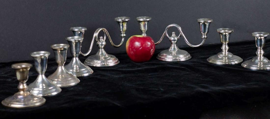 A COLLECTION OF 20TH C. STERLING SILVER CANDLE HOLDERS - 7