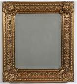 AN EARLY 20TH C MIRROR WITH EMBOSSED BRASS FRAME