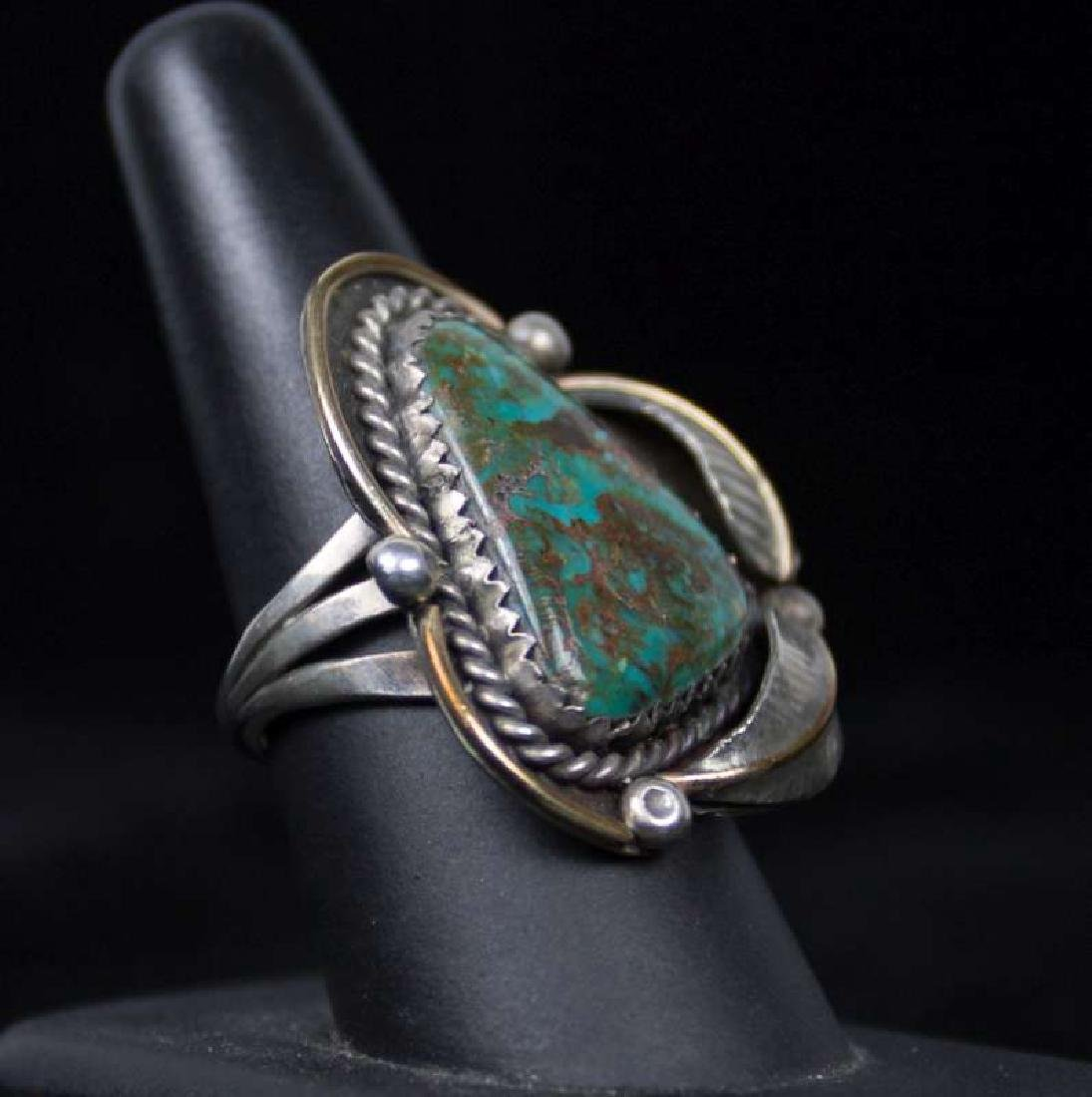 A NAVAJO STERLING AND TURQUOISE RING