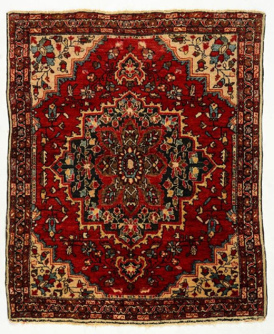 A CIRCA 1930s PERSIAN SCATTER RUG WITH MEDALLION