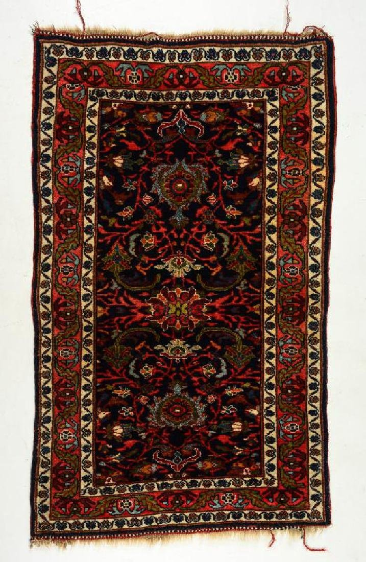 A CIRCA 1930s PERSIAN SCATTER RUG