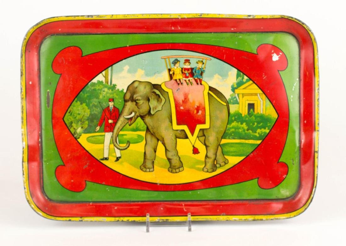 TIN LITHO CHILD'S TRAY WITH AN ELEPHANT TRAINER