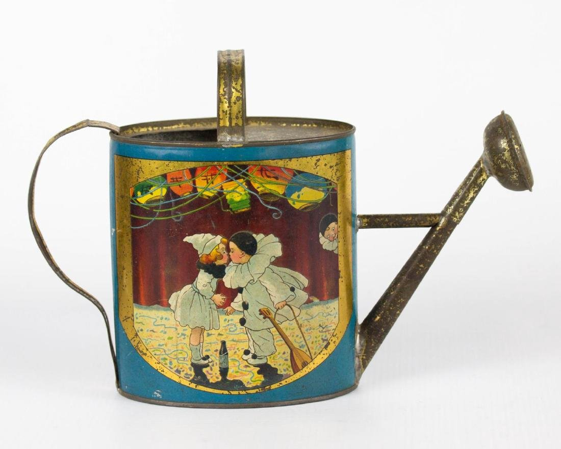A CHILD'S TIN LITHO WATERING CAN WITH PIERROT